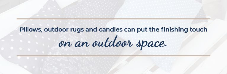 Outdoor pillows, rugs, and candles