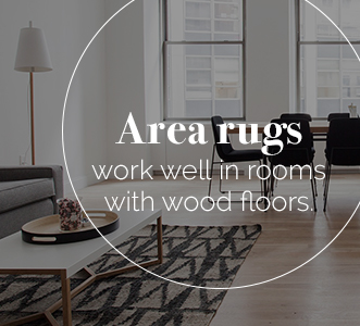 tone down wood with area rugs